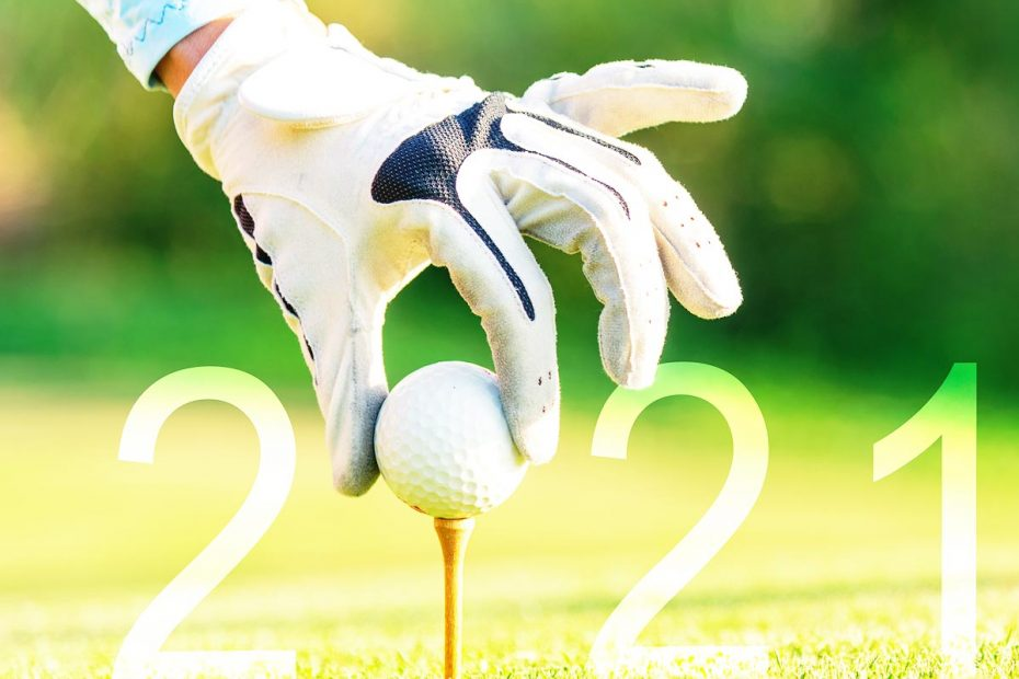 photo of gloved golfer's hand putting a golf ball on a tee. The ball is the zero in superimposed text: 2021.
