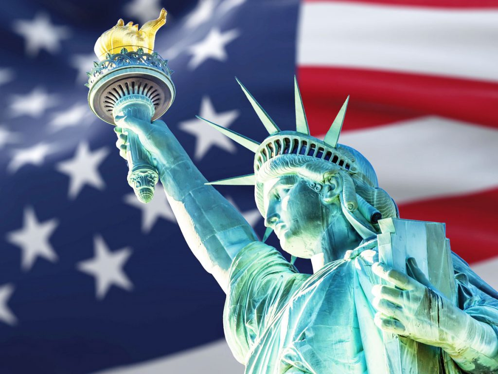Illustration of the Statue of Liberty with an American flag waving in the background