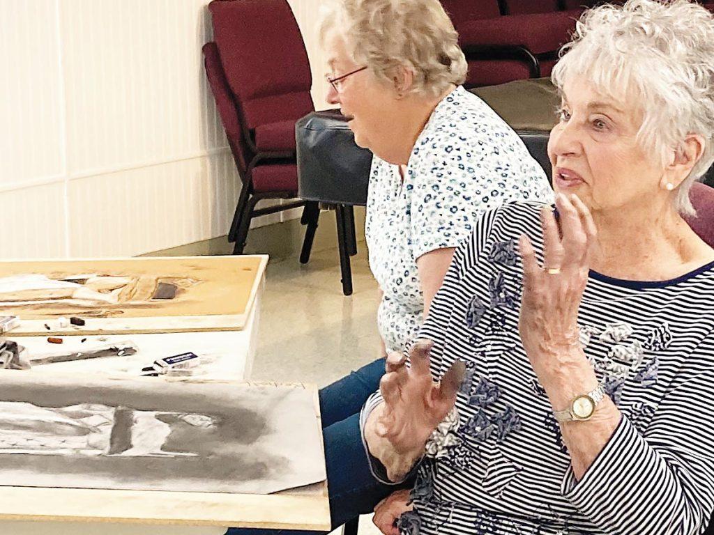 Photo of two senior women in an art class