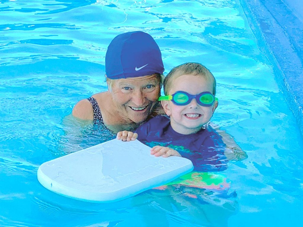 Photo of Nancy Kunau in the Rupert swimming pool with one of her swimming students