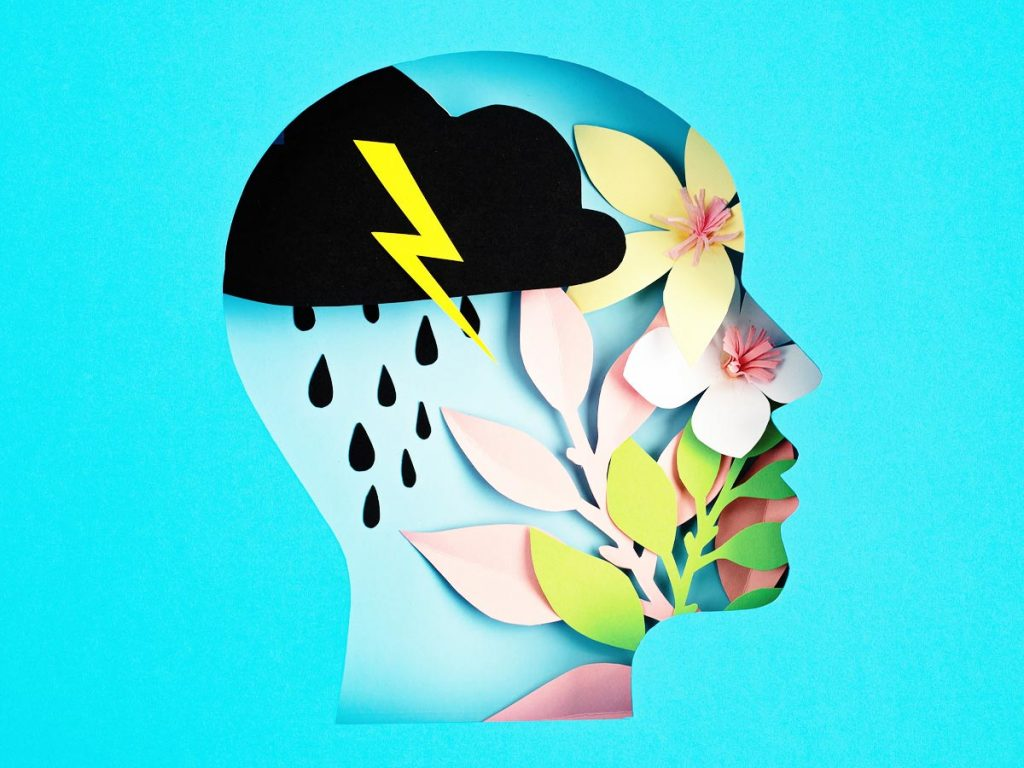 Illustration of a head filled with a thunderstorm and flowers, representing mental health on blue background